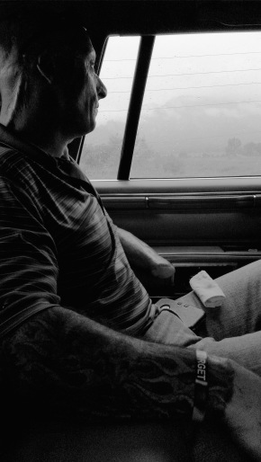 While driving to the hotel, I noticed Bobby looking out the window. We had been laughing with his friends, but he suddenly fell silent. I wanted to save this brief moment, as he caught his reflection in the window, and stared out into the mist.