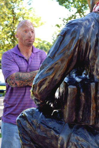 Two men to be admired. Bobby Henline stands before Danny Dietz's statue.